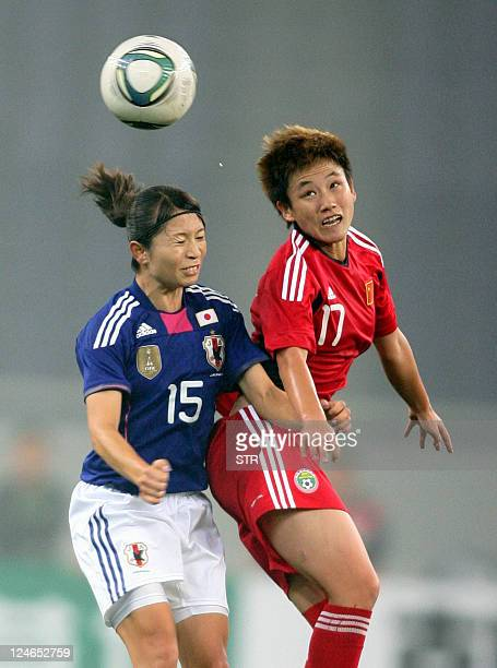 China's Pang Fengyue tussles for the ball against Japan's Sameshima Aya during their Asian women's football qualifier for the 2012 London Olympic...