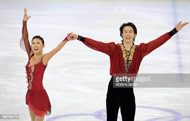 China's Pang Qing and Tong Jian acknowledge the cheers of the audience at the end of their free program routine at the 2010 Winter Olympics figure...