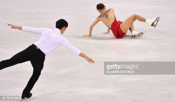 China's Peng Cheng and China's Jin Yang compete in the pair skating short program of the figure skating event during the Pyeongchang 2018 Winter...