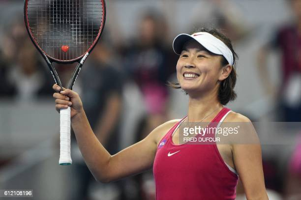 China's Peng Shuai reacts after beating Venus Williams of the US in their women's singles first round match at the China Open tennis tournament in...