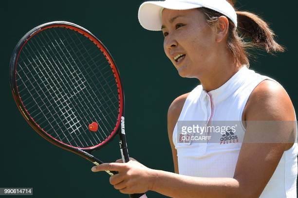 China's Peng Shuai reacts against Australia's Samantha Stosur during their women's singles first round match on the second day of the 2018 Wimbledon...