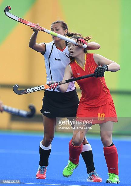 China's Peng Yang and Germany's Selin Oruz clash during the women's field hockey China vs Germany match of the Rio 2016 Olympics Games at the Olympic...