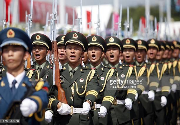 China's Peoples' Liberation Army soldiers march at the Ngong Shuen Chau Barracks in Hong Kong on July 1 to mark the 18th anniversary of Hong Kong's...