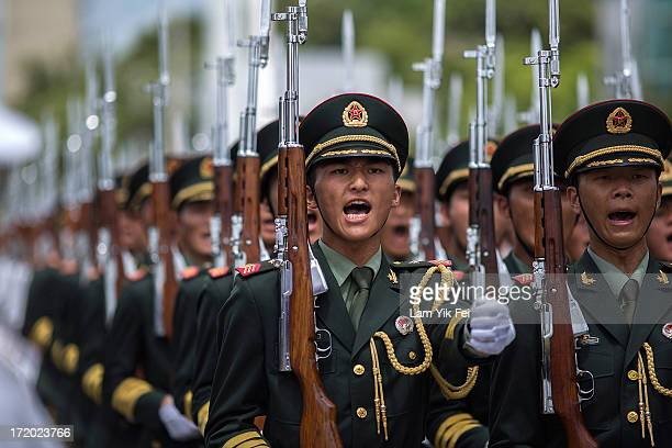 China's Peoples' Liberation Army soldiers march during the Hong Kong Special Administrative Region Establishment Day holiday open day at the Ngong...