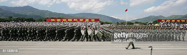 China's Peoples' Liberation Army soldiers parade to mark the establishment of the PLA at a military barracks in Hong Kong 01 August 2004 In a show of...