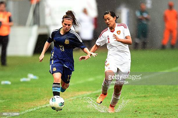 China's player Li Jiayue vies for the ball with Argentina's player Camila Gomez during their Brasilia International Tournament football 3rd place...