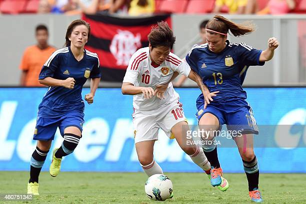 China's player Li Ying vies for the ball with Argentina's player Camila Gomez during their Brasilia International Tournament football 3rd place...