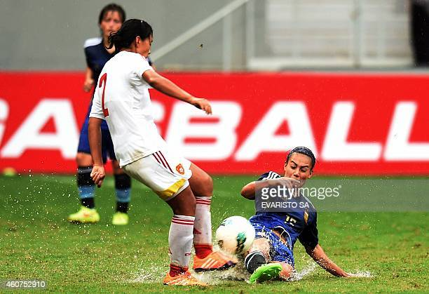 China's player Liu Shanshan vies for the ball with Argentina's player Yael Oviedo during their Brasilia International Tournament football 3rd place...