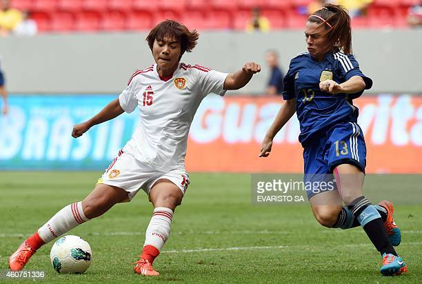 China's player Wang Shuang vies for the ball with Argentina's player Camila Gomez during their Brasilia International Tournament football 3rd place...