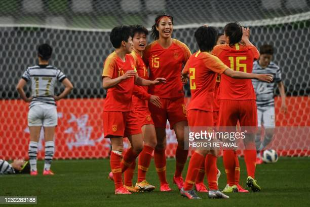 China's players celebrate a goal during the qualifying play-off second leg women's football match for the Tokyo 2020 Olympic Games between China and...