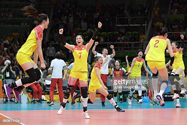 China's players celebrate after winning their women's Gold Medal volleyball match against Serbia at Maracanazinho Stadium in Rio de Janeiro on August...