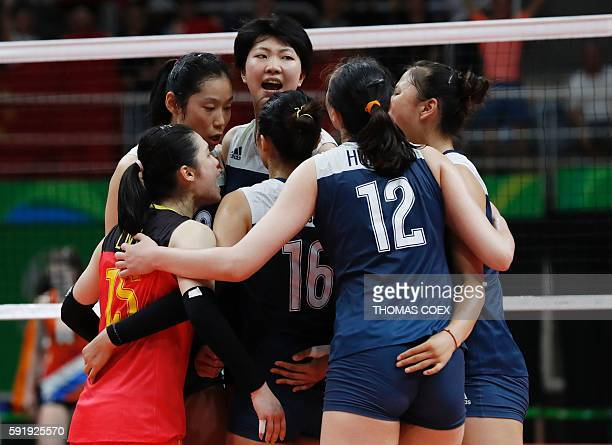 China's players huddle on the court during the women's semifinal volleyball match between China and the Netherlands at Maracanazinho Stadium in Rio...