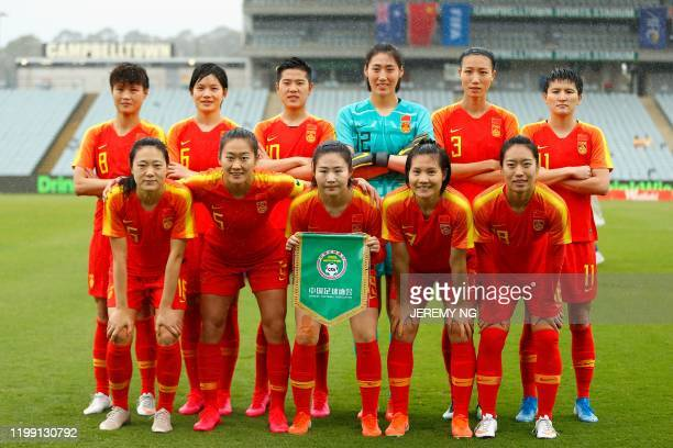 China's players pose for a team photo prior to the women's Olympic football tournament qualifier match between China and Thailand at Campbelltown...