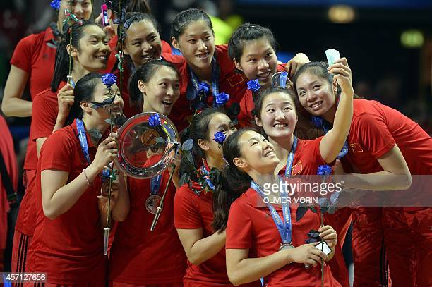 China's players take a selfie celebrating their Silver medal after the Volleyball Women's World Championship final match USA vs China in Milan on...
