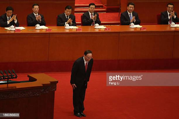 China's Politburo Standing Committee member Wang Qishan bows after speaking during the opening ceremony of the 11th National Women's Congress at the...
