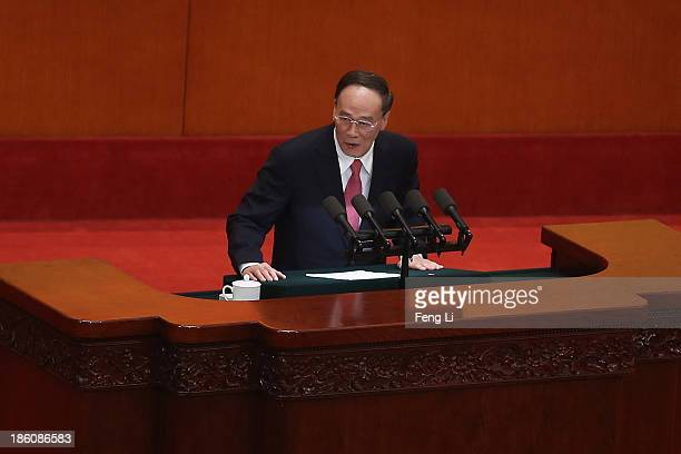 China's Politburo Standing Committee member Wang Qishan speaks during the opening ceremony of the 11th National Women's Congress at the Great Hall of...