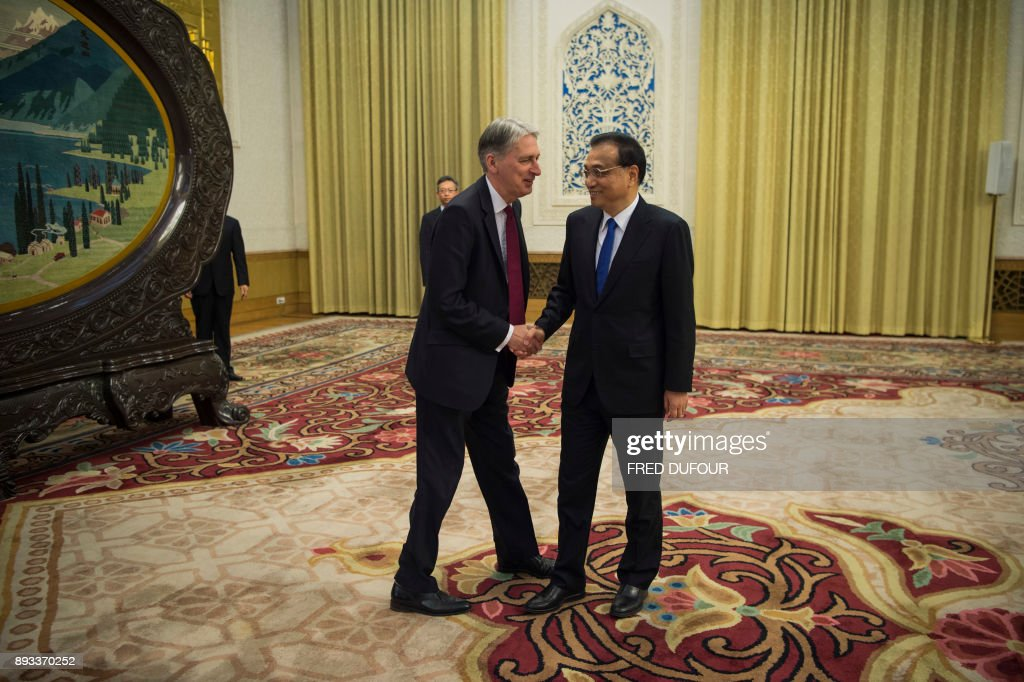 China's Premier Li Keqian meets Britain's Chancellor of the Exchequer Philip Hammond at the Great Hall of the People in Beijing on December 15, 2017. /