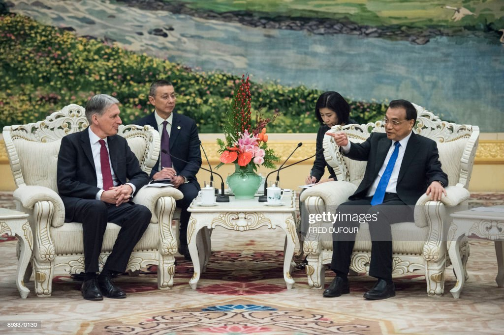 China's Premier Li Keqian speaks with Britain's Chancellor of the Exchequer Philip Hammond during a meeting at the Great Hall of the People in Beijing on December 15, 2017. /