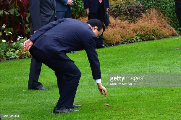 China's Premier Li Keqiang accepts a challenge from a Maori warrior during a welcome ceremony at Government House in Wellington on March 27 2017 Li...