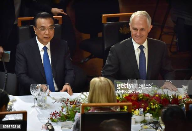 China's Premier Li Keqiang and Australia's Prime Minister Malcolm Turnbull speak with Lucy Turnbull during a luncheon at Parliament House in Canberra...