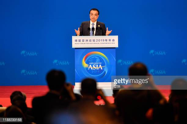 China's Premier Li Keqiang delivers a speech during the opening of the Boao Forum for Asia Annual Conference 2019 in Boao, south China's Hainan...