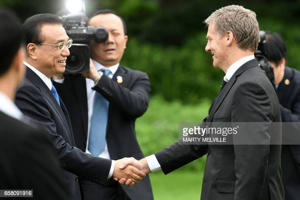 China's Premier Li Keqiang is greeted by New Zealand's Prime Minister Bill English during a welcome ceremony at Government House in Wellington on...