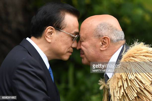 China's Premier Li Keqiang is welcomed to Government House by a Maori elder during a welcome ceremony in Wellington on March 27 2017 Li is on a...