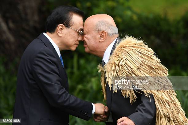 TOPSHOT China's Premier Li Keqiang is welcomed to Government House by a Maori elder during a welcome ceremony in Wellington on March 27 2017 Li is on...