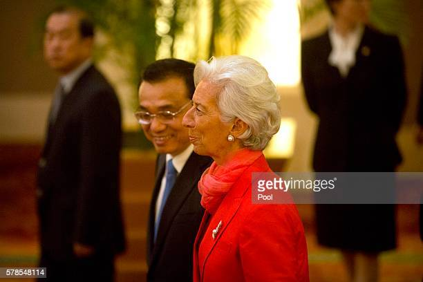 China's Premier Li Keqiang, left, and International Monetary Fund director Christine Lagarde, right, walk together as they arrive for the 1+6...