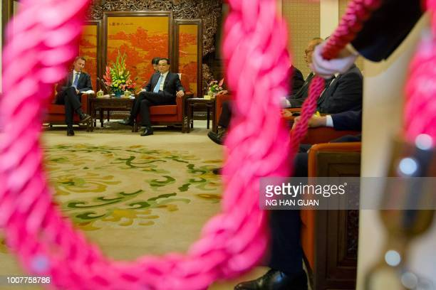 China's Premier Li Keqiang meets with Britain's Foreign Minister Jeremy Hunt at the Zhongnanhai leadership compound in Beijing on July 30 2018...
