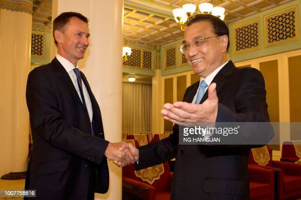 China's Premier Li Keqiang shakes hands with Britain's Foreign Minister Jeremy Hunt before a meeting at the Zhongnanhai leadership compound in...