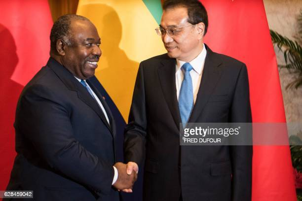 China's Premier Li Keqiang shakes hands with Gabon's President Ali Bongo Ondimba at the Great Hall of the People in Beijing on December 8 2016 / AFP...