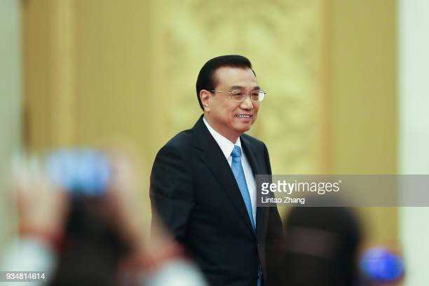 China's Premier Li Keqiang speaks attends a news conference following the closing of the First Session of the 13th National People's Congress at the...