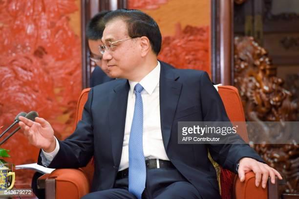 China's Premier Li Keqiang speaks during his meeting with Nepal's Deputy Prime Minister Krishna Bahadur Mahara at Zhongnanhai Leadership Compound in...