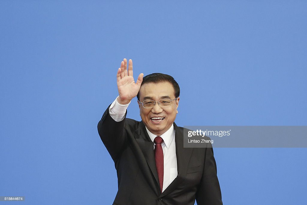 China's Premier Li Keqiang waves as leaving the annual news conference following the closing session of the National People's Congress at the Great Hall of the People on March 16, 2016 in Beijing, China. China's development of the 'new economy' is to cultivate new momentum to promote China's economic transformation, Li said.