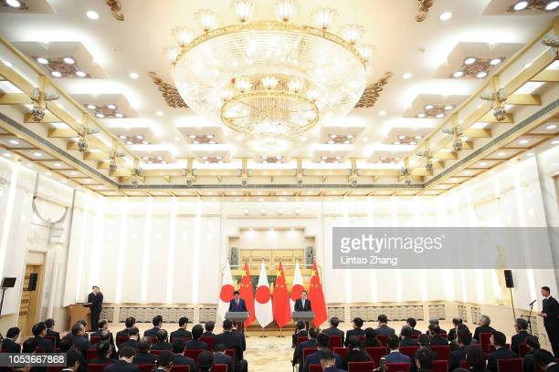 China's Premier Li Keqiang with Japanese Prime Minister Shinzo Abe attend a joint news conference at the Great Hall of the People inside the Great...