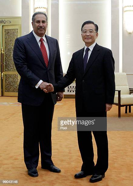 China's Premier Wen Jiabao shakes hands with Qatar's Prime Minister Sheikh Hamad Bin Jassim Bin Jabr AlThani during a meeting at the Great Hall of...