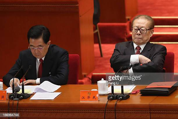 China's President Hu Jintao and former President Jiang Zemin attend the closing session of the 18th National Congress of the Communist Party of China...