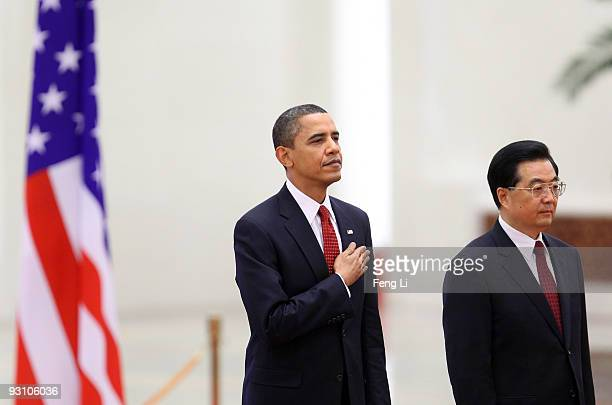 China's President Hu Jintao and U.S. President Barack Obama listen to national anthems during a welcome ceremony at the Great Hall of the People on...