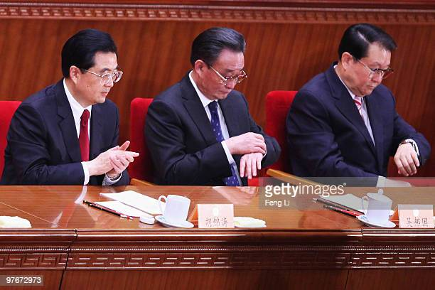 China's President Hu Jintao, Chairman of the Standing Committee of the National People's Congress Wu Bangguo and Chinese Communist Party Propaganda...