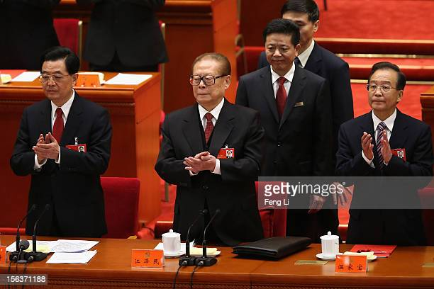 China's President Hu Jintao former President Jiang Zemin and Chinese Prime Minister Wen Jiabao attend the closing session of the 18th National...