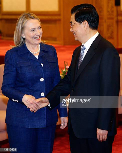 China's President Hu Jintao shakes hands with US Secretary of State Hillary Clinton during a meeting at the Great Hall of the People on May 4 2012 in...
