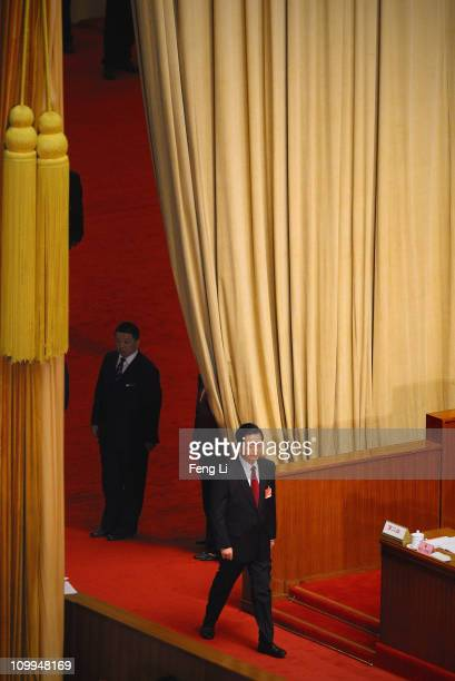 China's president Hu Jintao walks into the meeting hall during a plenary session of the National People's Congress at the Great Hall of the People on...