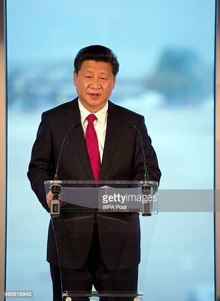 China's President Xi Jinping addresses an audience of dignitaries including the British Prime Minister David Cameron at Manchester airport on October...