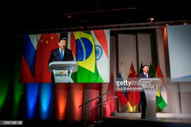 China's President Xi Jinping addresses delegates at a Business Forum organised during the 10th BRICS summit on July 25, 2018 at the Sandton...