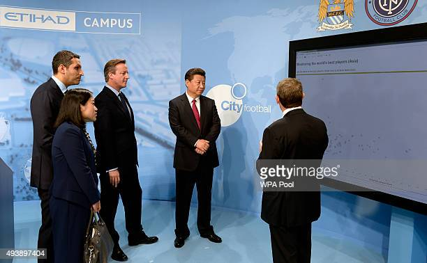 China's President Xi Jinping and Britain's Prime Minister David Cameron are given a demonstration on player monitoring and recruitment with...
