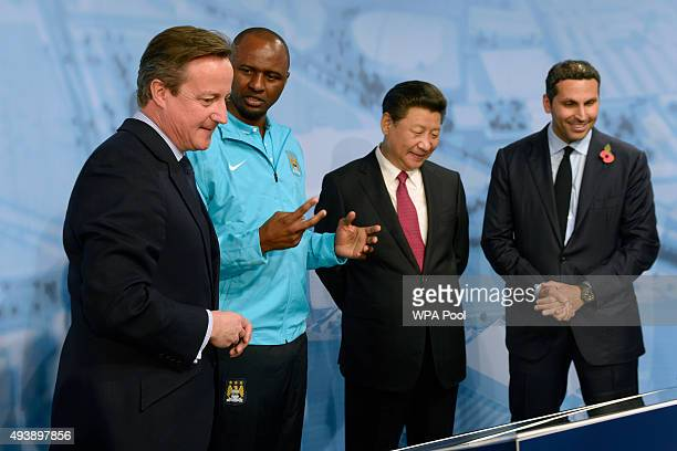 China's President Xi Jinping and Britain's Prime Minister David Cameron meet Patrick Vieira and chairman Khaldoon Al Mubarak during a visit to the...
