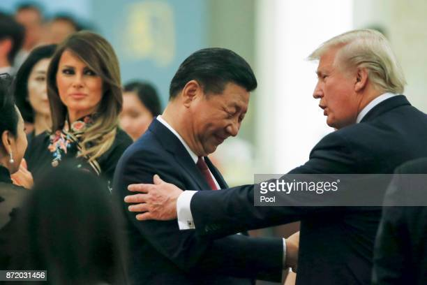 China's President Xi Jinping and China's first lady Peng Liyuan and US President Donald Trump and first lady Melania attend a state dinner at the...