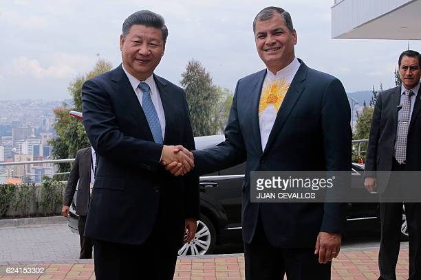 China's President Xi Jinping and Ecuador's President Rafael Correa shake hands as they arrive at the facilities of the Integrated National Center of...
