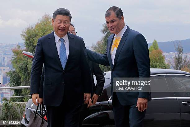 China's President Xi Jinping and Ecuador's President Rafael Correa arrive at the facilities of the Integrated National Center of Security Ecu 911 in...
